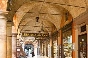 The covered sidewalks of Bologna are great for sightseeing on foot, window shopping, shade and rainy days
